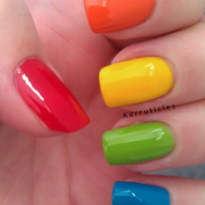 Skittle manicure red orange yellow green blue nails
