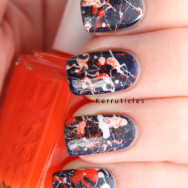 Navy, orange and white splatter manicure nails