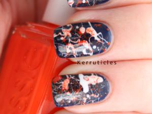Navy, orange and white splatter manicure nails