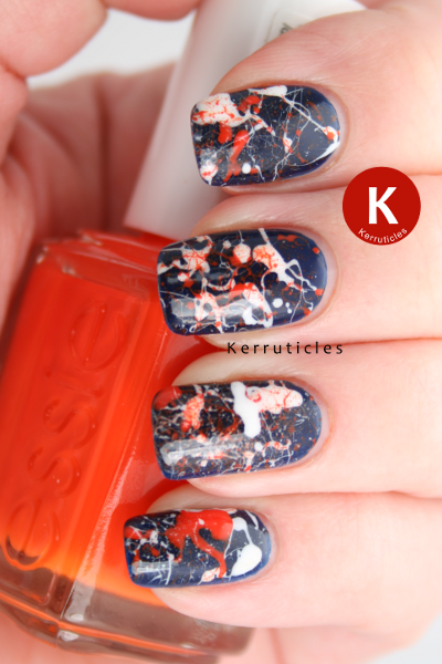 Navy, orange and white splatter manicure