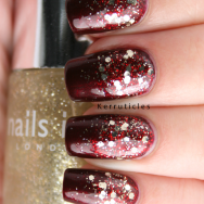 Glitter gradient in red and gold nails