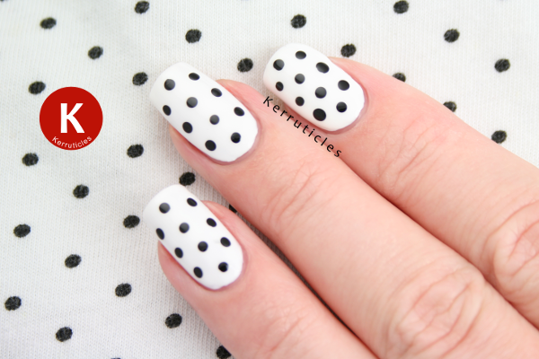 Black and white polka dot nails with top
