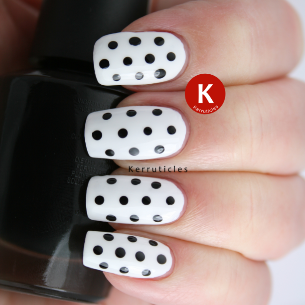 Black and white polka dots nails