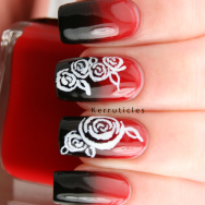Black and red gradient using Barry M Blood orange and W7 Black, with freehand roses in white acrylic paint