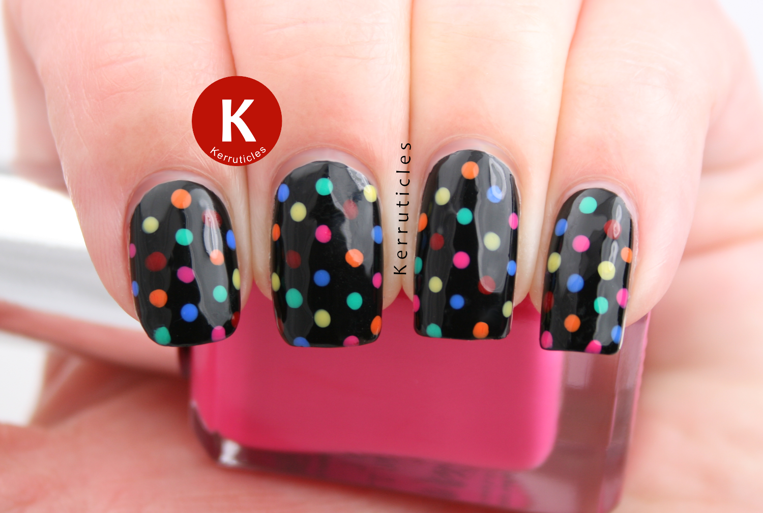 Multi-coloured polka dots on black