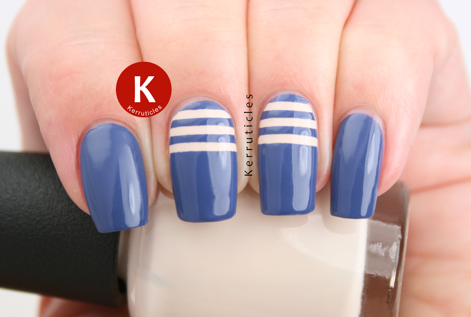 Cream stripes over blue using Rimmel Navy Seal and OPI My Vampire Is Buff