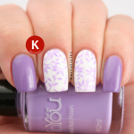 Lilac and white stamped nails