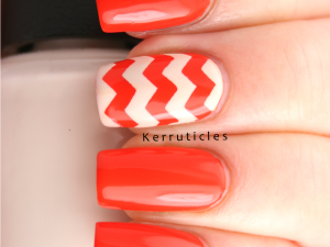 Orange and cream zigzags using OPI A Roll In The Hague and My Vampire Is Buff