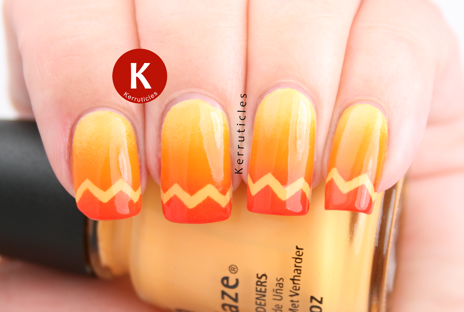 Orange gradient with zigzag tips, using China Glaze Metro Pollen-Tin, China Glaze Papaya Punch and Ciaté Hopscotch