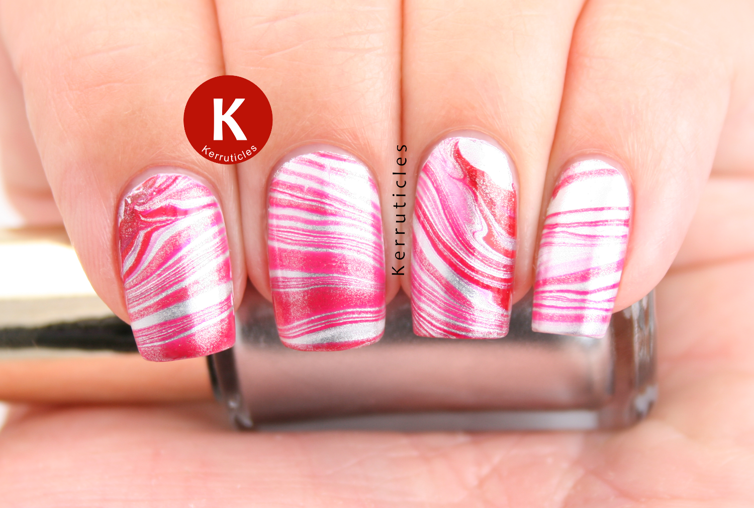 Red and silver water marble using L'Oréal Femme Fatale and Sublime Platine