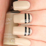 Beige with stencilled black lines nails