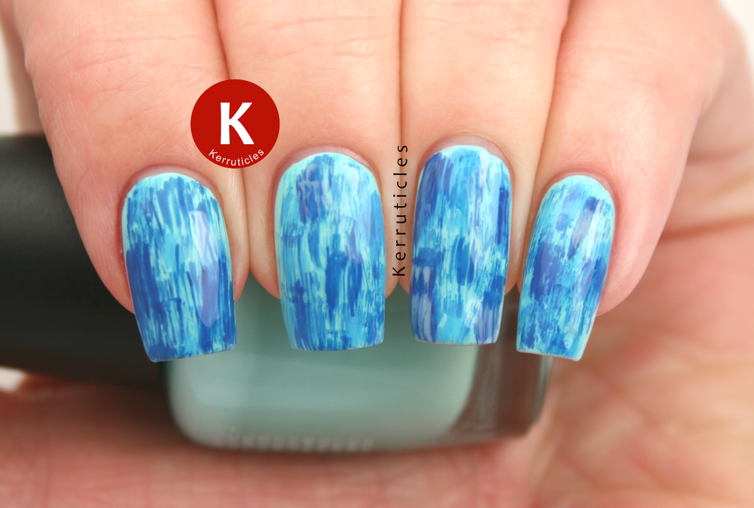 Blue distressed nails using LA Colors Beach Babe, Revlon Coastal and Revlon Indigo Night