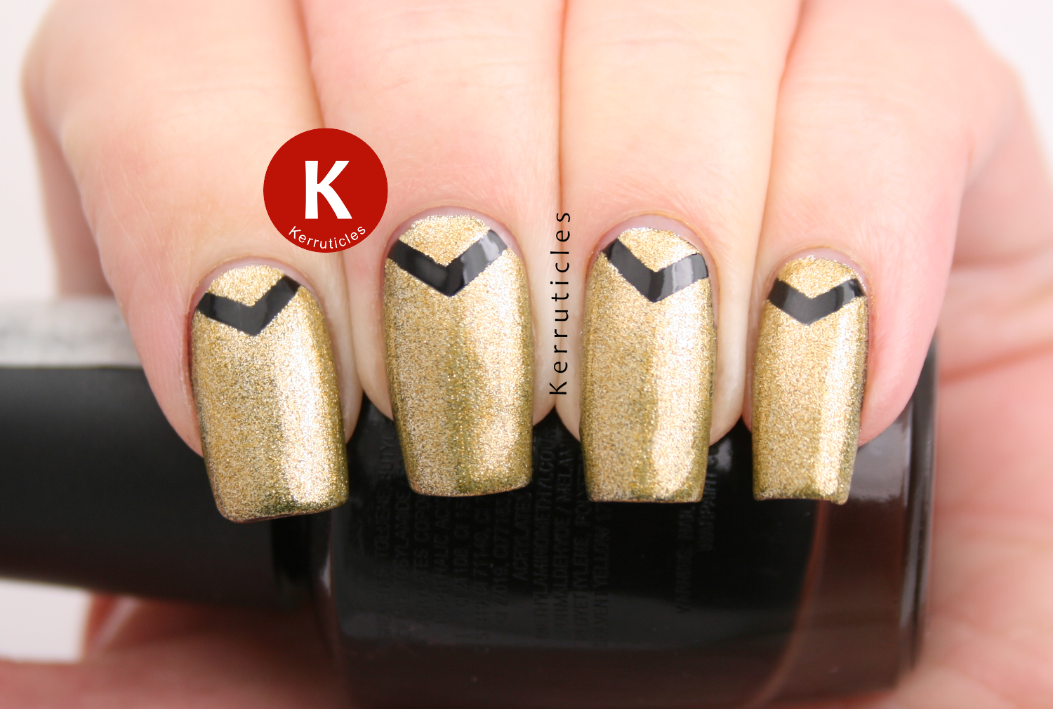 Gold with black chevrons, using W7 Black and Ciaté Ladylike Luxe
