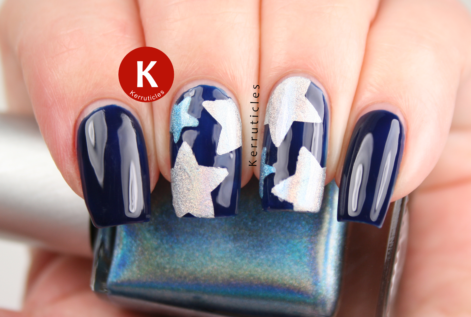 Navy with holographic stars using Ciaté Power Dressing, GOSH Holographic Hero and Color Club Over The Moon
