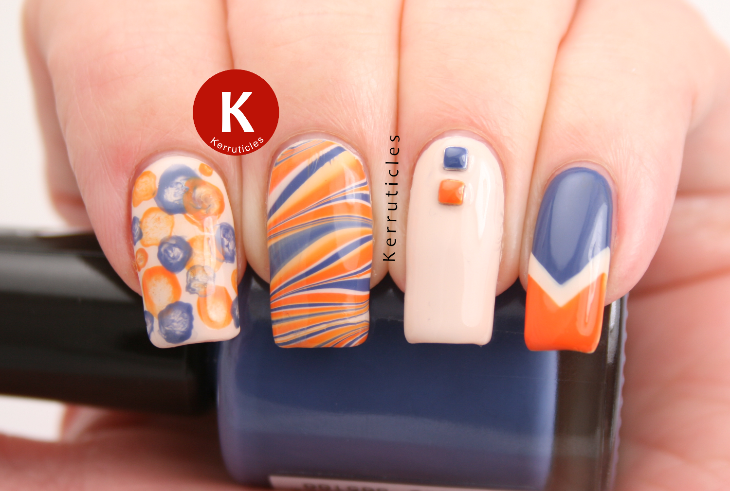 "Orange, blue and cream ""kitchen sink"" manicure, using OPI My Vampire Is Buff, Rimmel Navy Seal and Barry M Mango"