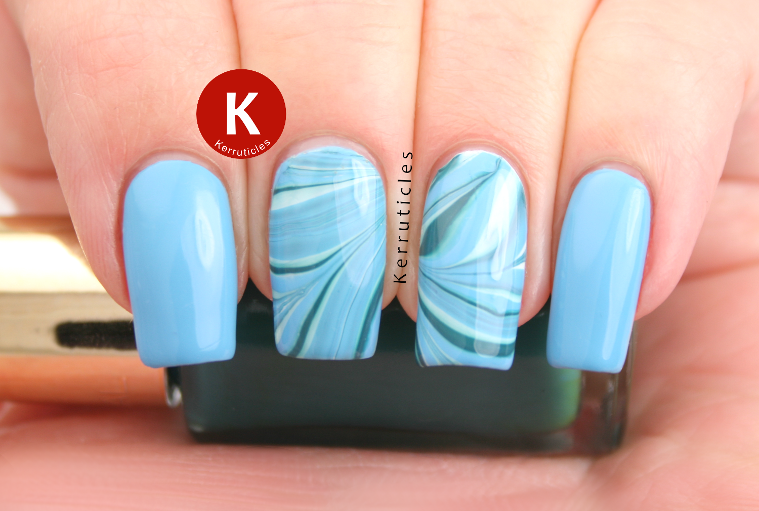 Blue and green water marble using L'Oréal French Riviera, L'Oréal Blue Reef and Barry M Blueberry Icecream