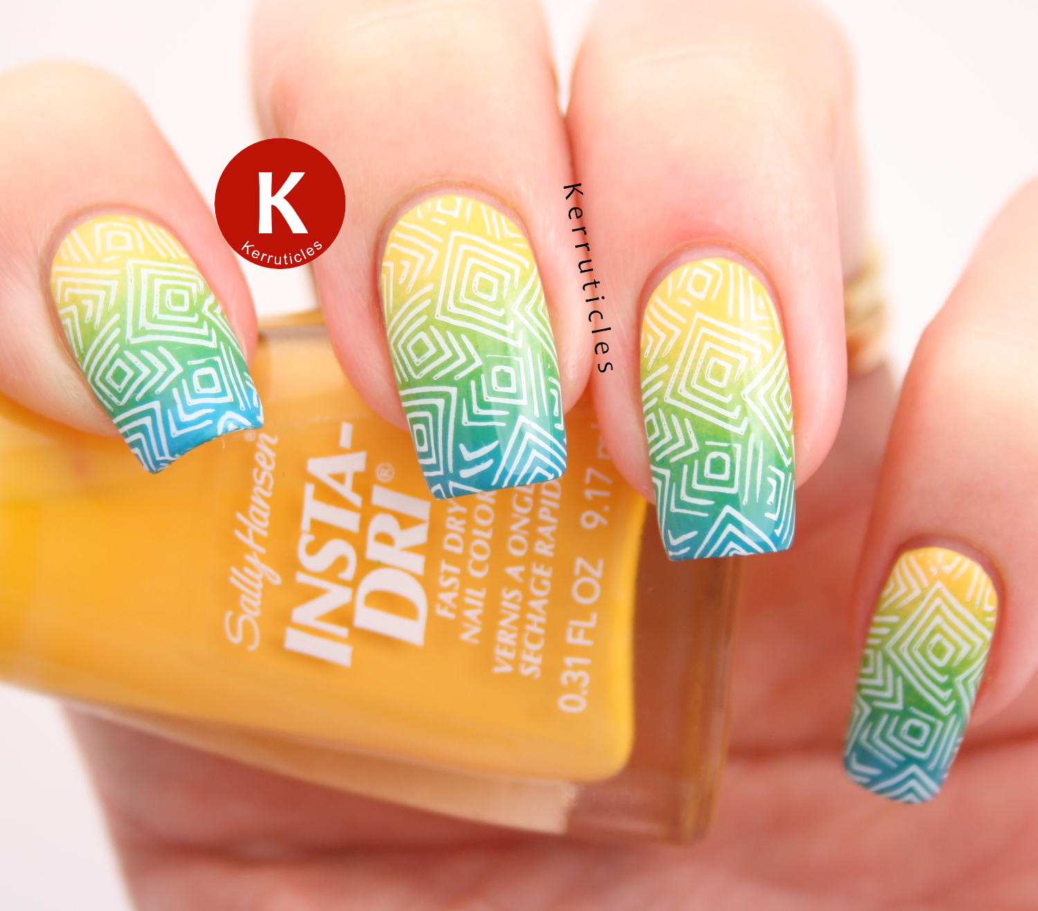 Yellow, green and blue gradient using Sally Hansen Butter-fly Stroke, Lickety-Split Lime and Brisk Blue, stamped with a geometric pattern from MoYou Nails Pro Board VII