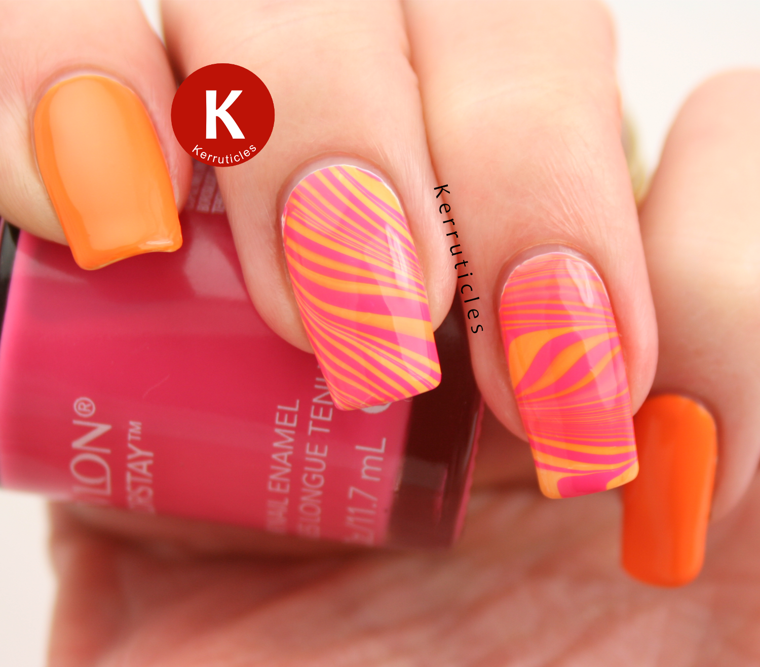 Pink and orange water marble using Revlon Colorstay polishes in Passionate Pink and Sorbet