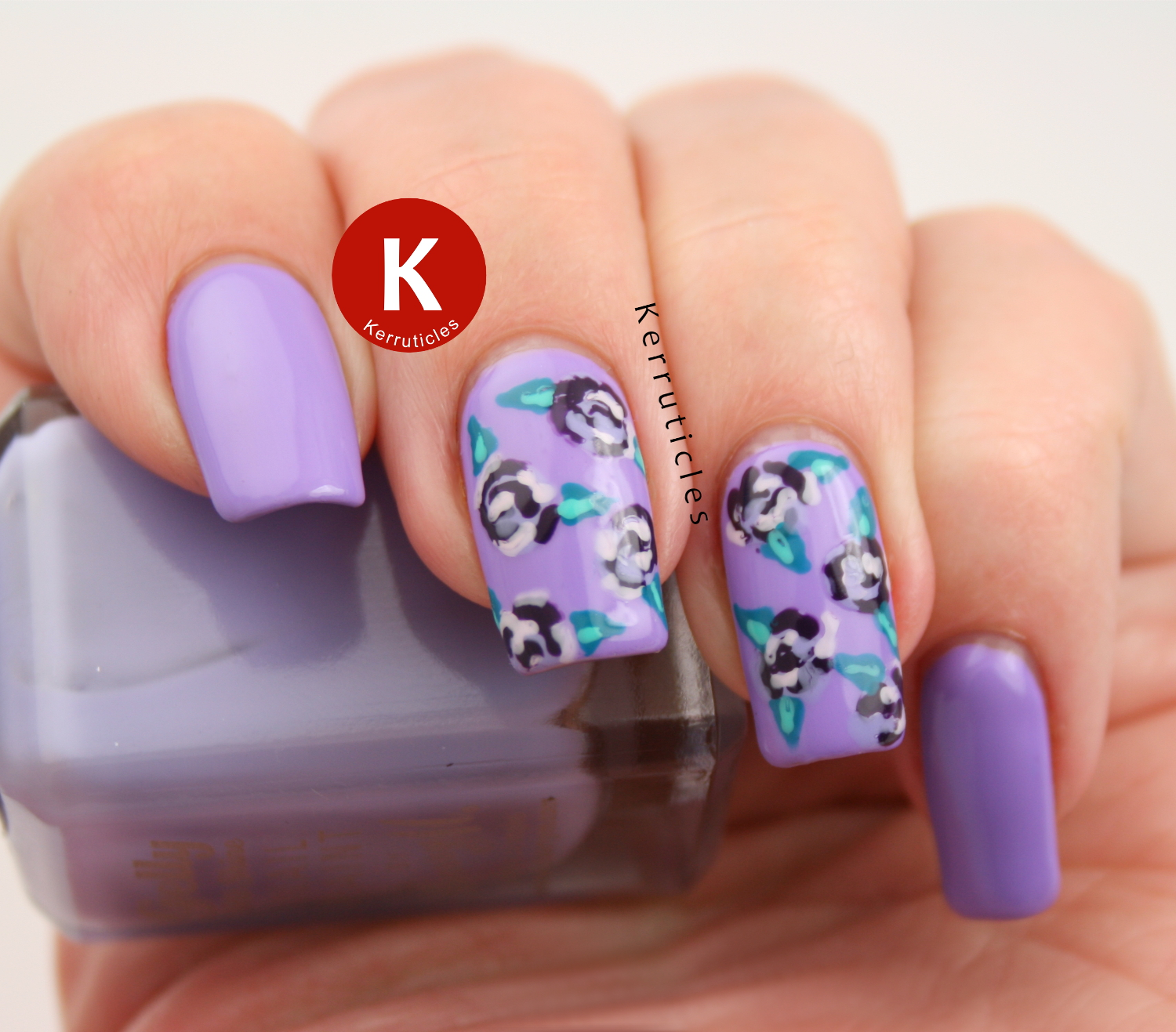 Lilac and teal roses using Barry M polishes on a base of Bundle Monster Voodoo Lounge