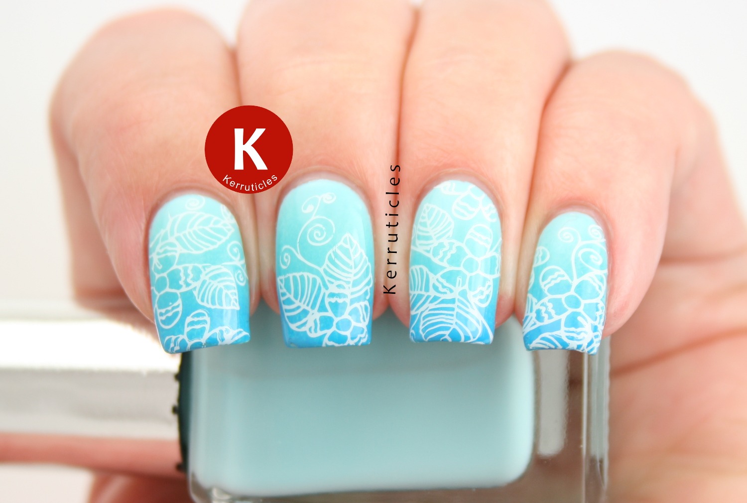 Aqua gradient using Barry M Sky Blue, Turquoise and Cyan Blue, with white floral stamping using Born Pretty Store BP-56
