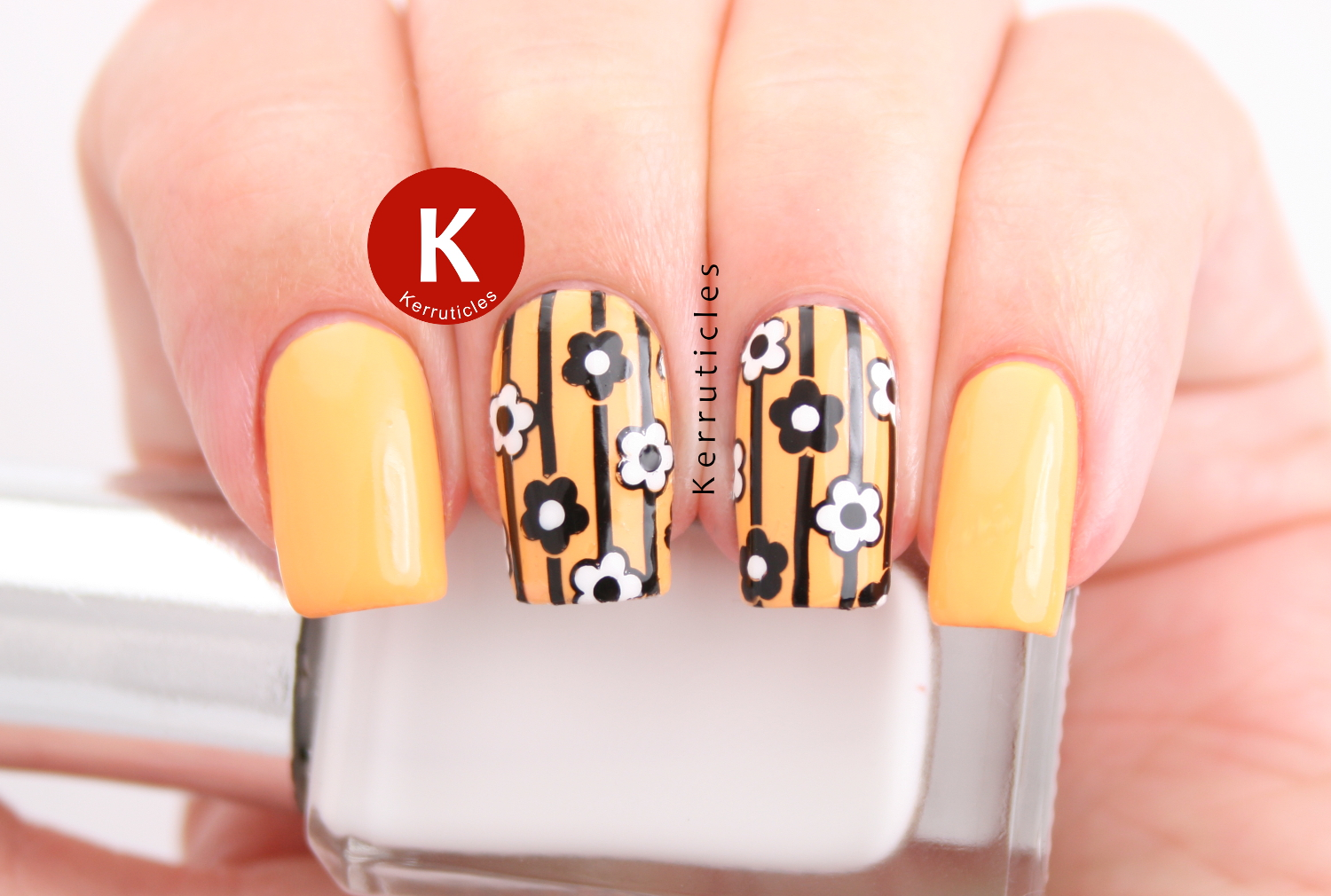 Yellow, black and white stripes and flowers: reverse stamping using Born Pretty Store BP-65 over China Glaze Metro Pollen-Tin