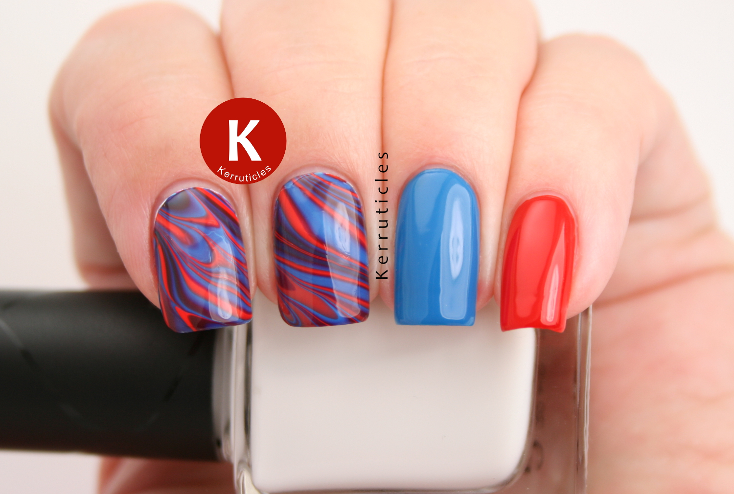 Red, blue and purple water marble using Nella Milano polishes: The Rubinator, True Blue and A Royal Affair