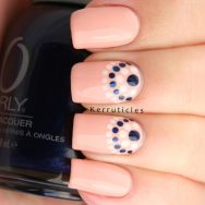 Peach, cream and navy dotted half moons nails