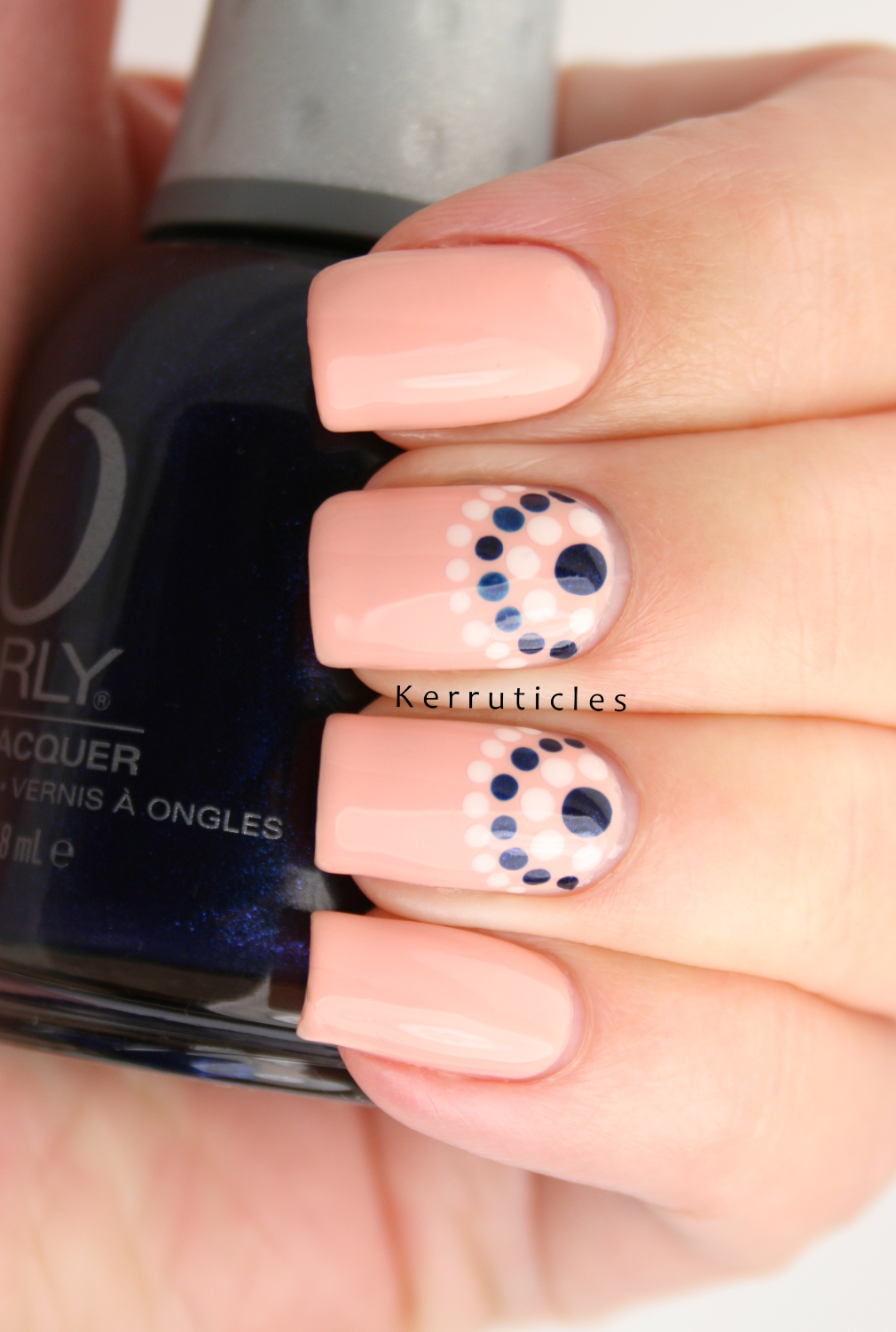 Peach Cream And Navy Dotted Half Moons Nails