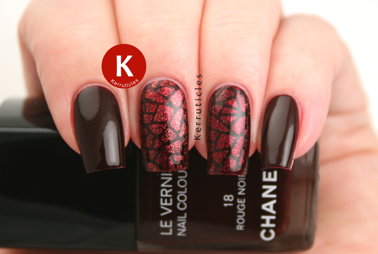 Red geometric nails, using Chanel Rouge Noir, and Barry M Sparkling Ruby sponged over Bundle Monster stencils