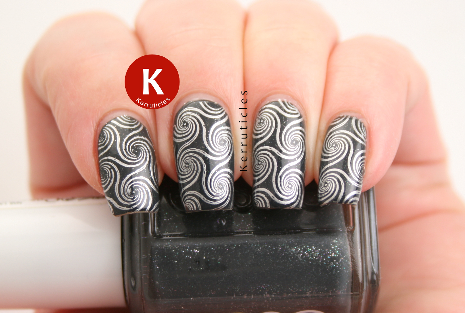 Silver swirls using Born Pretty Store BP-L003 over Essie Cashmere Bathrobe