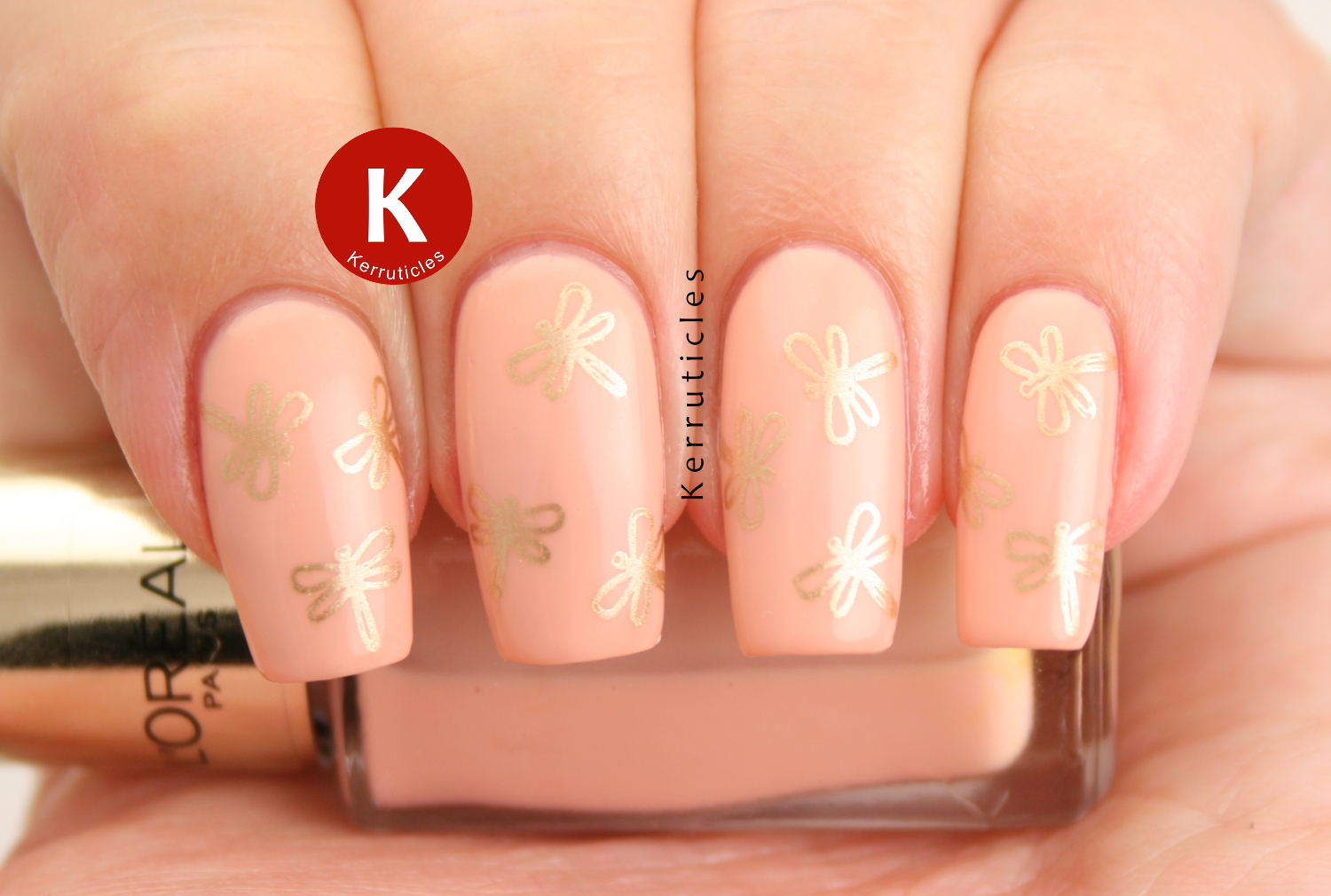 Peach dragonfly nails
