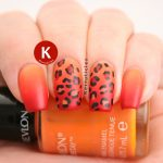 Orange and red gradient leopard nails