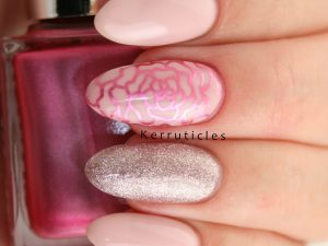 Pale pink gel nails with stamping and glitter